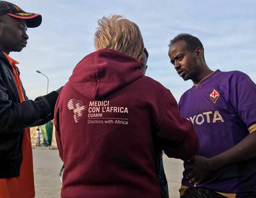 Staff from doctors with Africa CUAMM bring medical care directly to a migrant community in Puglia, Italy