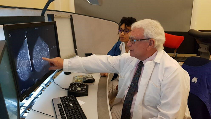 Dr. Laszlo Tabar in action by his breast imaging PACS workstation