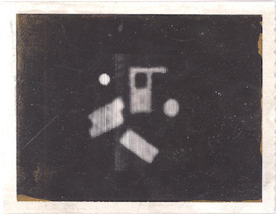 Polaroid image of the first CT scan.