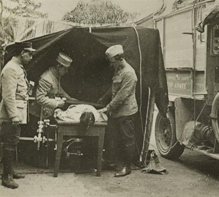 Medics locating a bullet with an x-ray machine